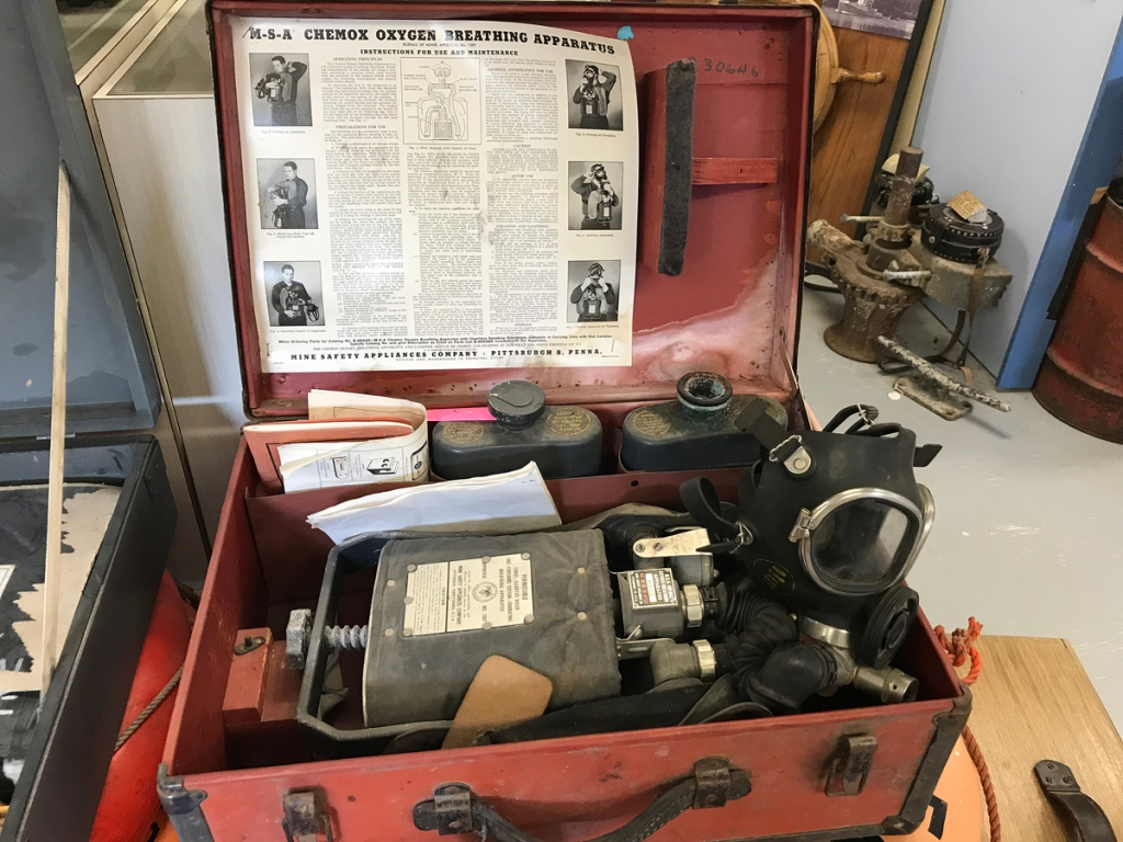 "A red suitcase contains a ""chemox oxygen breathing apparatus"" in case of mustard gas attack."