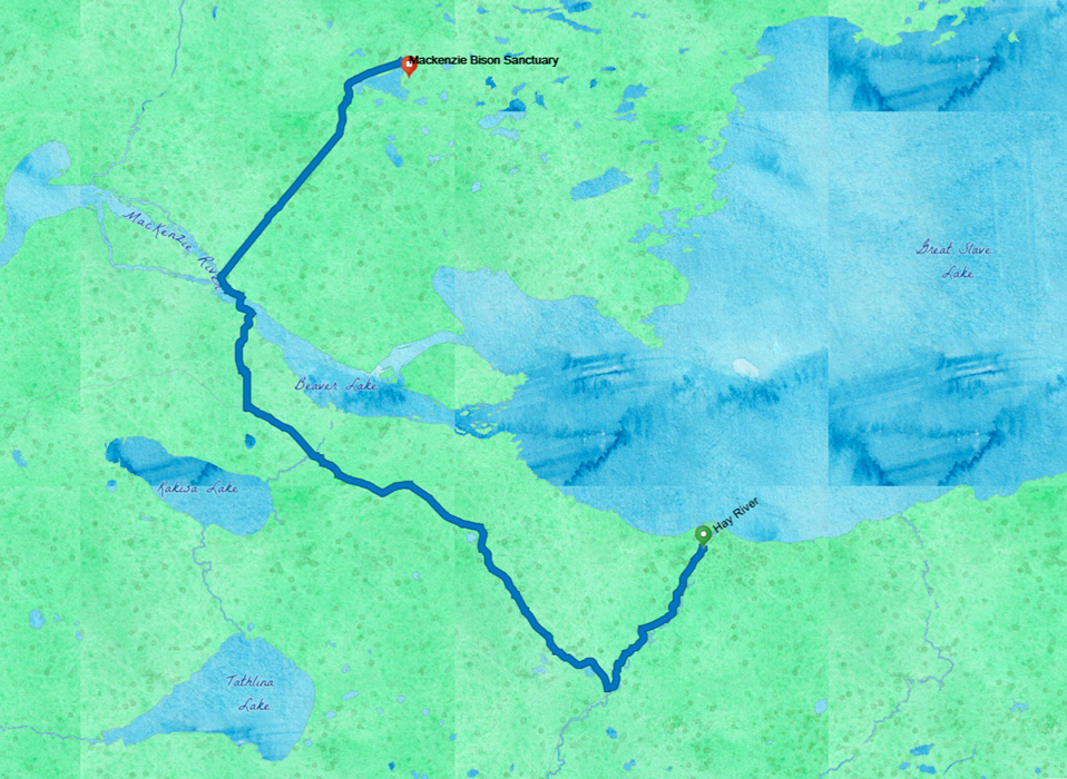 A watercolor map shows Great Slave Lake in Blue on the upper right, with a blue route line from Hay River, on the shore, northwest to cross the Mackenzie River, and then across to the Bison Sanctuary.