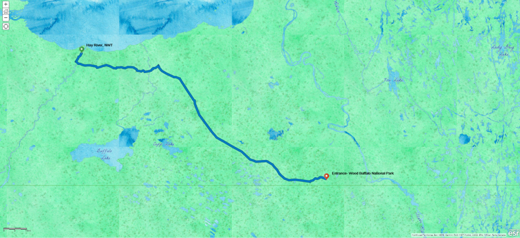 Watercolor basemap, bright green and blue for water, showing a route from Hay River, NWT, to the Entrance of Wood Buffalo National Park, just north of the Alberta border.